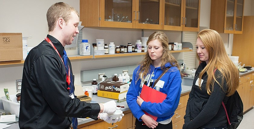 PharmD student showing a compounding demonstration